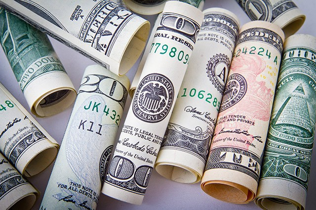rolls of money, lots of money