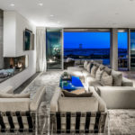 Living room of contemporary Newport Beach beach house showing lifeguard tower in background
