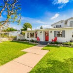 Eastside Costa Mesa home front view white house with red door